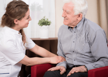 Young therapist during elderly patient's home visit
