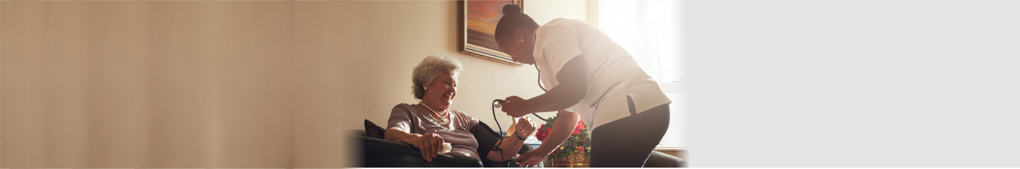 Nurse measuring blood pressure of elderly woman